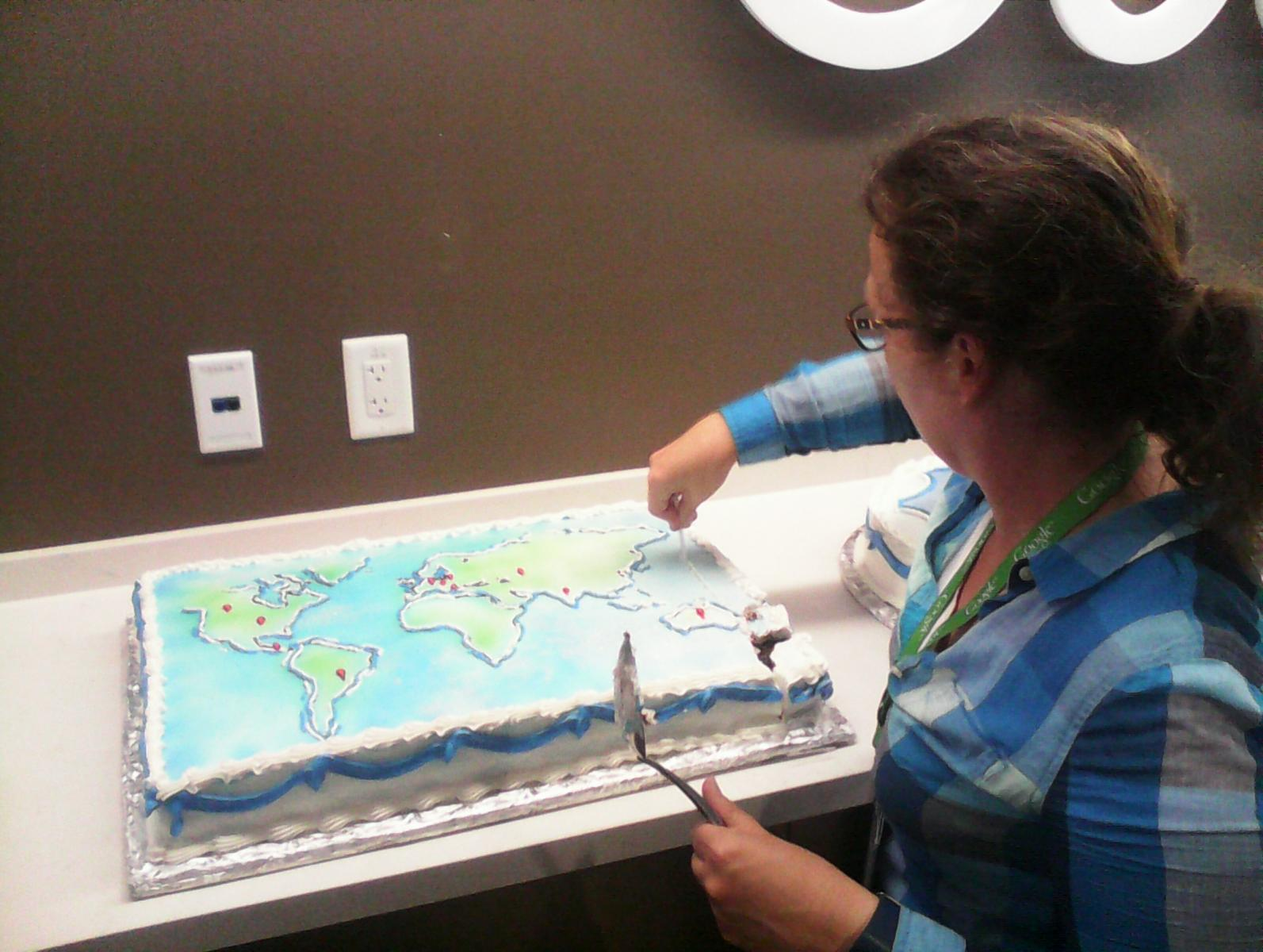 Stephanie cutting the map cake