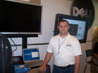 Urias at the Dell booth at OpenSource World.